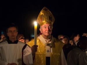 Cardinal-Vincent-Nichols-walks-prayerfully-with-a-lit-candle_medium